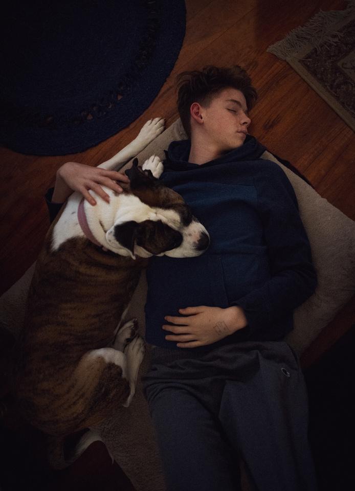 Sleepy Teenager and His Dog